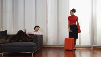 Young Woman Preparing to Leave Man