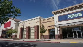 Two retail storefronts available for lease in a strip mall